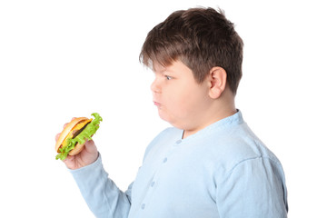 Overweight boy with burger on white background
