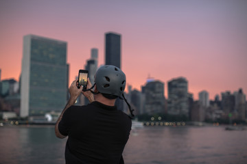 Man taking photos during sunset in the city