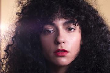 Curly woman in studio