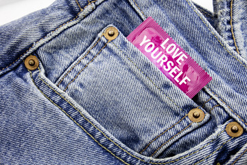 Handwriting Announcement text showing Love Yourself. Business concept for Positive Slogan For You Written on condom pack put in the small pocket to pants jeans.