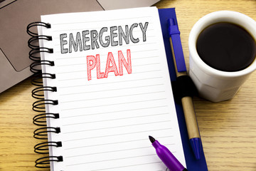 Word, writing Emergency Plan. Business concept for Disaster Protection written on notebook book on the wooden background in the Office with laptop coffee