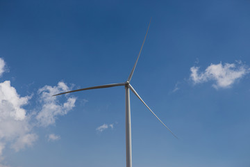 wind turbine on blue sky with Cloud