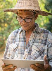 Farmers Asian use digital tablet to monitor information