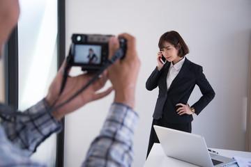 Behind scene photographer woking take photo women;