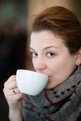 Woman Enjoying Hot Cappuccino Coffee, Close up