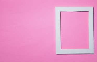 Empty frame  flat lay on pink pastel background with copy space. Minimal concept.