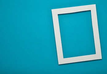 Empty frame on blue pastel wall with copy space. Minimal concept.