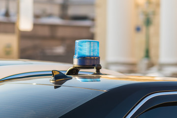 blue emergency flashing light on the car roof, clsoeup