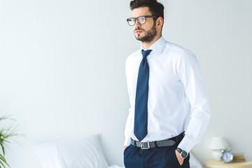 handsome businessman in white shirt and tie standing in bedroom Fotobehang