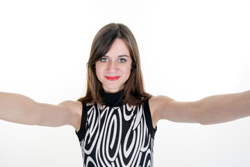 Portrait of young attractive woman making selfie photo on smartphone isolated on a white background