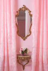 Classic framed mirror in pink interior