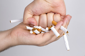 Broken cigarette on white background. healthy concpet