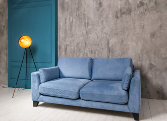 Living room interior with blue sofa and retro lamp