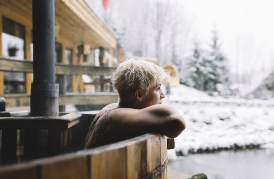 Woman relaxing in hot spring