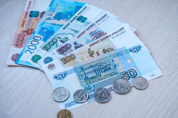 Russian paper money and coins lie on the table