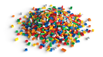 Pile of colored toy bricks isolated on white background.