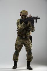 Photo of military man with gun