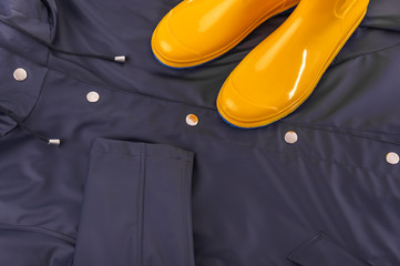 Rubber boots on a raincoat.