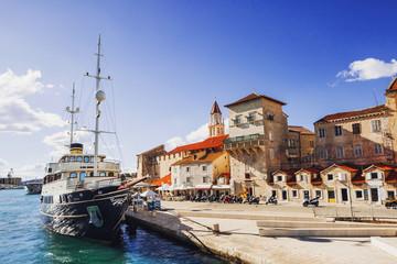 Trogir town, Croatia. View of the old town and sailing ship. Famous Croatian tourist destination. Dalmatian coast