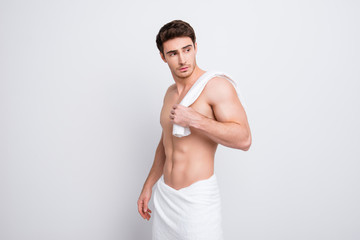 Portrait of confident stunning dreamy athletic sporty guy holding towel on shoulder, he is going after morning shower, isolated on white background with copy space
