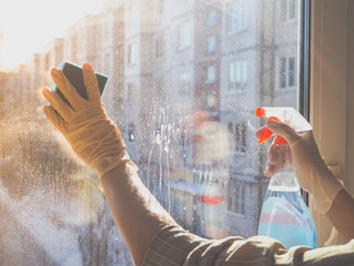 House cleaning. Washing dirty window glass detergent in winter.