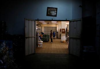 Palestinians work at Wael Al-Wadiya's snacks and chips factory, east of Gaza City