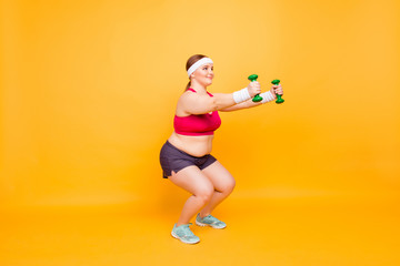 Young woman in exercise clothes with hand weights
