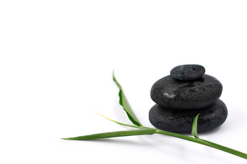 Spa still life stock images. Black massage stones. Black stones on a white background. Massage stones for relaxation. Pile of black stones