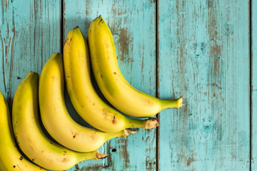 Bananas on a rustic blue wooden table