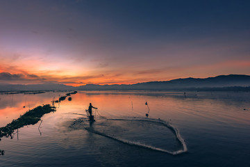 Fisherman's dancing on the water in sunrise view