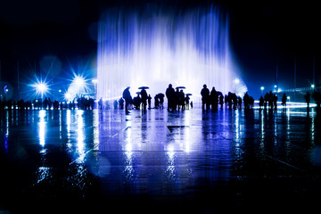 People looks the light and music fountain show. Dancing water