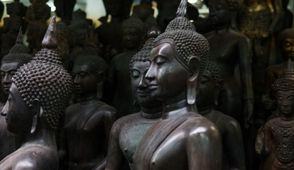 Big Buddha statues in the local Thai market. Antique Buddha statues close-up