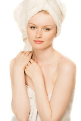 beautiful young woman with clear skin in white towel isolated