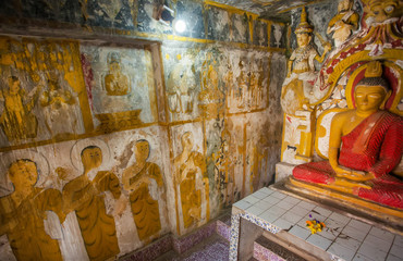 Monks on fresco and meditating Buddha statue inside the 14th century buddhist temple