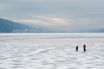 People enjoy a winter afternoon on the ice of the frozen Lake of Joux in Le Pont