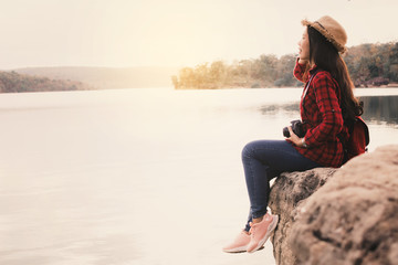 Asian woman shooting picture in nature , Relax time on holiday concept travel,selective and soft focus,tone of hipster style