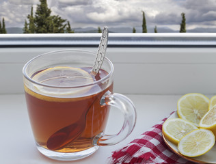 A Cup of tea and a lemon on the window sill