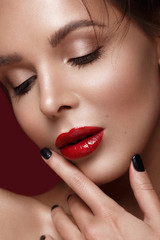 beautiful girl in Hollywood image with classic makeup and red lips. Beauty face. Photo taken in the studio.