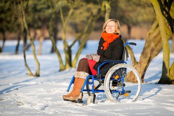 happy young adult woman on wheelchair