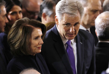 House Majority Leader Kevin McCarthy speaks with Minority Leaderr Nancy Pelosi (L) as they await the start as the late evangelist Billy Graham lies in honor in the Rotunda of the U.S. Capitol in Washington