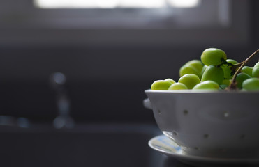 View of fresh green grapes in a white ceramic strainer