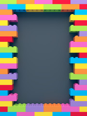 Frame of stacked colorful toy bricks