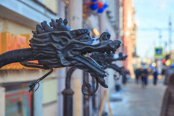 cast-iron head of the Chinese dragon on the street close-up