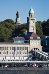 The harbor pier of Landungsbruecken with the monument of Chancellor Bismarck in the background, Hamburg, Germany.