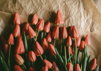 High angle view of tulips with crumpled papers on table