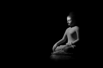 Buddha statue in the dark - light and shadow