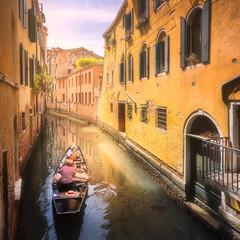 Venecia canal with boats and gondolas, Italy