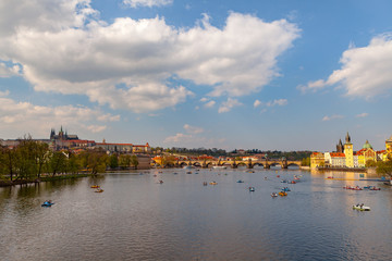 Wall Murals Place of worship View on the river Vltava with boats. Old town of Prague, Czech Republic, summer season.