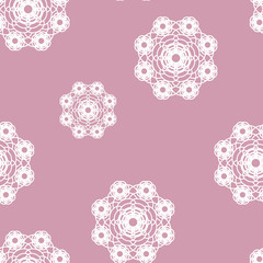 white lace knitted graceful floral napkin on pink background