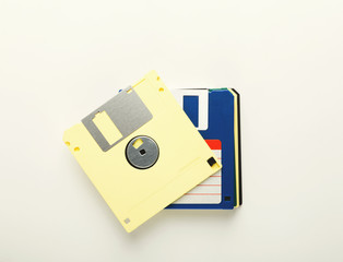 Pile of retro floppy disks. Diskettes isolated on white background